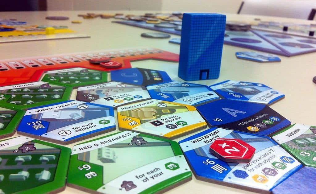 Picking the best three player board games is not easy, but the tested and proven Suburbia made it a no brainer.