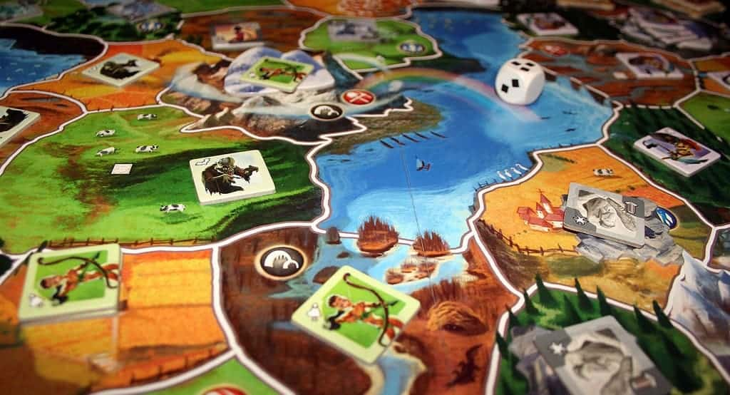 If you are looking for the fantasy games for kids, Small World is highly recommended.